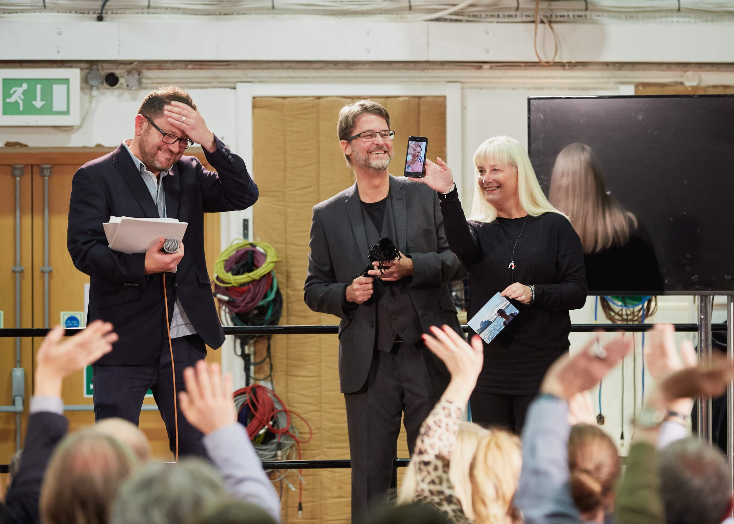 Zak's mother with Zak on Facetime receiving his diploma from Abbey Road Institute campus manager Mike Sinnott and programme director Carlos Lellis.